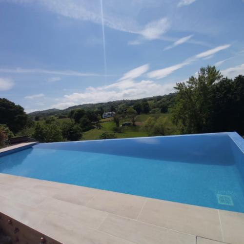 Defelma-piscina-infinity-oviedo-landscape