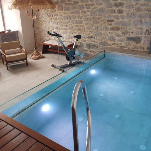 Defelma-piscina-interior-obra-transparente-escalera